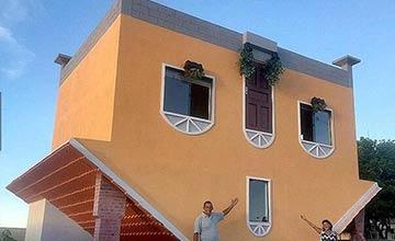 现实中的颠倒房屋引围观 许多人百思不得其解