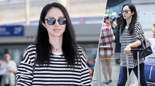 董璇回国现身机场 面露微笑状态轻松