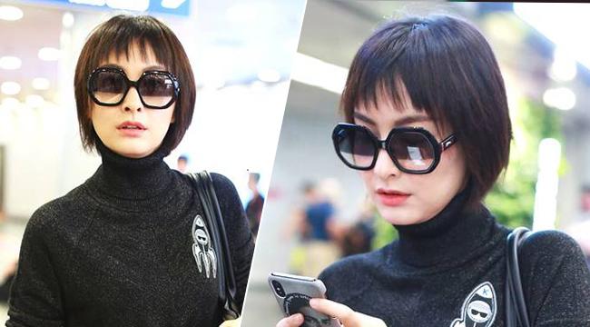 吴昕娃娃头黑超遮面现身机场 瘦身有成时尚感up