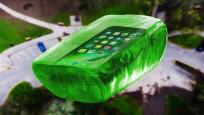 作死小伙将iPhone 7包裹在糖果中从高处抛下,你猜它会怎样?
