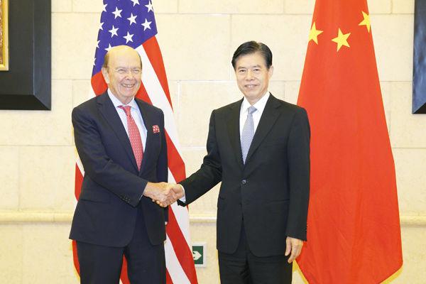 3  9月24日下午,中国商务部部长钟山在京与来访的美国商务部长罗斯举行工作会谈。图片来源:商务部网站
