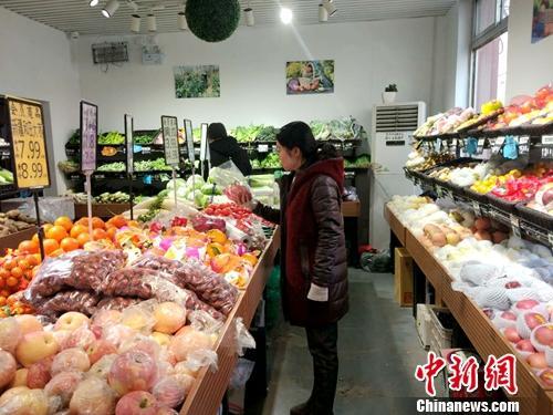 北京居民在购物。<a target='_blank' href='http://www.chinanews.com/' ></p><p class=