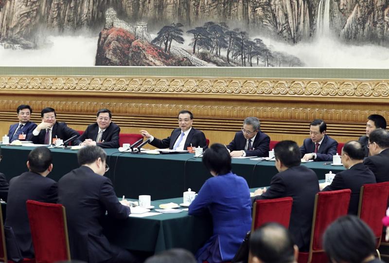 3月12日,中共中央政治局常委、国务院总理李克强参加十三届全国人大一次会议湖南代表团的审议。     新华社记者丁林摄